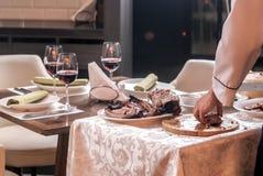 Cooking roast duck in restaurant Stock Image