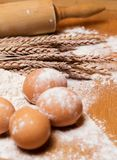 Cooking. Rolling pin and eggs in the flour Royalty Free Stock Photography
