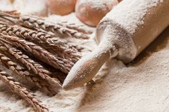 Cooking. Rolling pin and eggs in the flour Royalty Free Stock Image