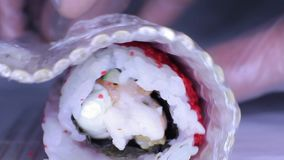 Cooking rolls of japanese cuisine stock video footage