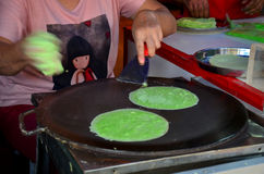 Cooking Roti Saimai (Cotton Candy) or Thai cotton candy burrito. Pancake at market in Ayutthaya, THailand royalty free stock photo