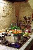 Cooking in rustic kitchen Stock Image
