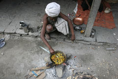 Cooking sadhu Royalty Free Stock Image