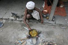 Cooking sadhu Royalty Free Stock Image