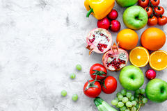 Cooking salad with fresh fruits and vegetables on stone background top view mock-up Royalty Free Stock Images