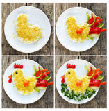 Cooking salad shaped or rooster symbol of New Year 2017 royalty free stock photos