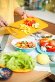 Cooking salad from vegetables Stock Images