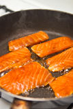 Cooking salmon. Cooking Teriaky marinade salmon in a pan Royalty Free Stock Photo