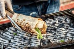 Cooking salmon kebab Royalty Free Stock Photos