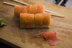 Cooking salmon rolls Royalty Free Stock Images