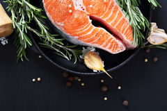 Cooking salmon on slate Royalty Free Stock Images