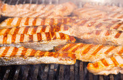 Cooking salmon steak on the grill Stock Images