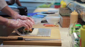 Cooking Of Salmon Sushi Roll. Royalty Free Stock Photography