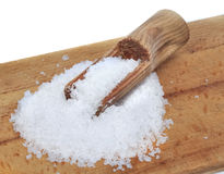 Cooking salt on wooden board with spoon Stock Photography
