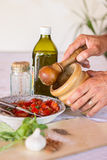 Cooking sauce using mortar and pestle Royalty Free Stock Photos