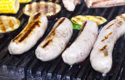 Cooking sausages on the grill Stock Photos