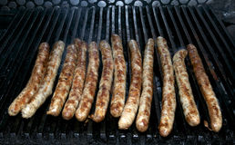 Cooking sausages on the grill Royalty Free Stock Images