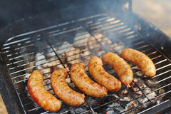 Cooking sausages Royalty Free Stock Image