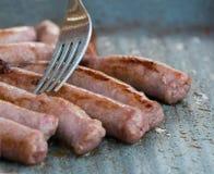 Cooking sausages Stock Photos