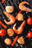 Cooking Scallops and shrimp on grill close-up. Vertical top view Royalty Free Stock Photo