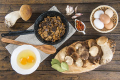 Cooking scrambled eggs with mushrooms Royalty Free Stock Photo