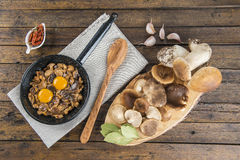 Cooking scrambled eggs with mushrooms Stock Photography