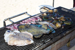 Cooking seafood on the grill Royalty Free Stock Images