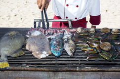 Cooking seafood on the grill Stock Images