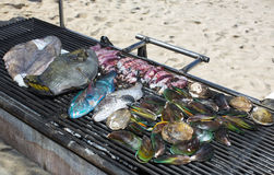 Cooking seafood on the grill Royalty Free Stock Photos