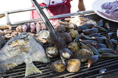 Cooking seafood on the grill Stock Photography
