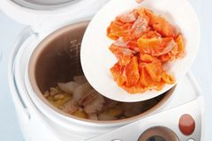Cooking seafood in Multicooker Royalty Free Stock Photos