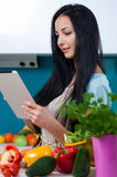 Cooking and searching for recipes online Royalty Free Stock Image