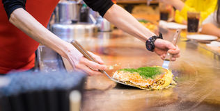 Cooking a Set of Japanese pizza on hot counter Royalty Free Stock Photography