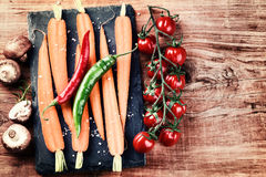 Cooking setting with fresh organic vegetables on old wood backgr Royalty Free Stock Image