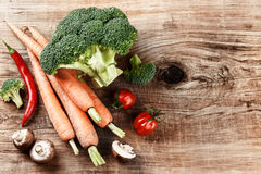 Cooking setting with fresh organic vegetables on old wood backgr Royalty Free Stock Photography