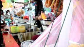 Cooking Shan inspired or Nan gyi thohk Noodle salad Burmese cuisine stock video