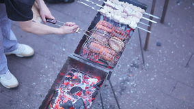Cooking shashlik and sausage stock video footage