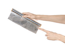 Cooking and shisha topic: human hand holding a foil isolated on Royalty Free Stock Photography