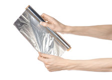 Cooking and shisha topic: human hand holding a foil isolated on Stock Image