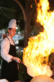 Cooking show. Chef cook making a show with flames while cooking in a restaurant. This show  takes place every week, in almost all five star Turkish resorts. This Stock Image