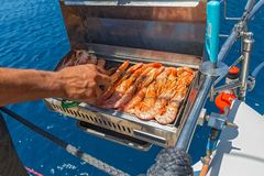 Cooking shrimp on the grill. During the cruise Stock Images