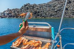 Cooking shrimp on the grill. During the cruise Royalty Free Stock Photography