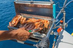 Cooking shrimp on the grill. During the cruise Stock Photography