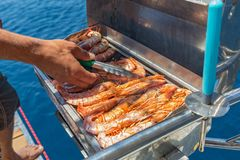 Cooking shrimp on the grill. During the cruise Royalty Free Stock Image