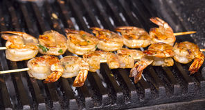 Cooking shrimp on the grill Stock Photo