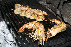 Cooking shrimp kebabs on the grill Stock Photography
