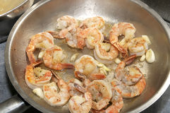 Cooking shrimp in a pan Royalty Free Stock Image