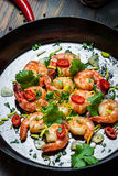 Cooking shrimps with fresh herbs Royalty Free Stock Photos