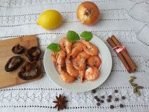 Cooking with shrimps onion mushrooms shiitake Royalty Free Stock Image