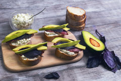 Cooking small sandwiches tapas with avocado royalty free stock photo